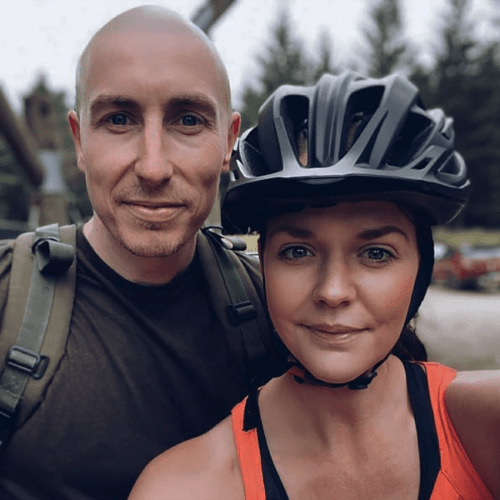 man with scalp micropigmentation standing with his wife