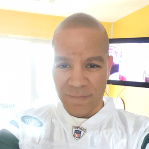selphie of man with scalp micropigmentation taken in his house