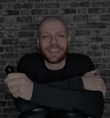 image of a man in black sitting